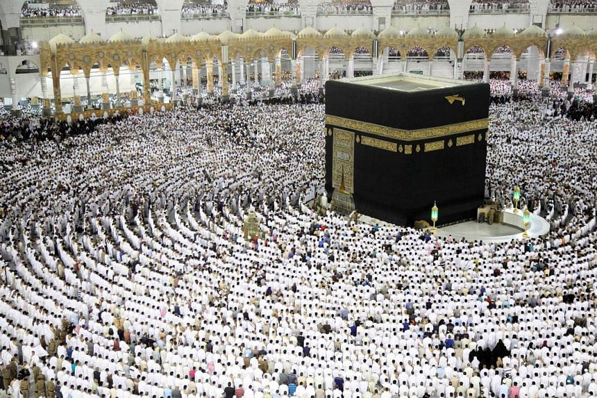 Muslim worshippers pray at the Kaaba, Islam's holiest shrine, at the Grand Mosque in Saudi Arabia's holy city of Mecca on June 23, 2017.