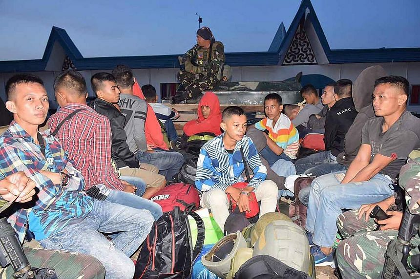 An undated handout showing men at a Zamboanga City military base who were arrested for allegedly planning to help militants in Marawi. A military spokesman said those arrested were all Filipinos.
