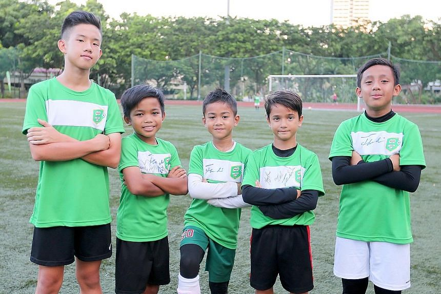 Alvin Wong (far left) is among five children selected for a trip to Barcelona to train at the FCBEscola Soccer School in October. They were chosen during the Milo Soccer Cup.