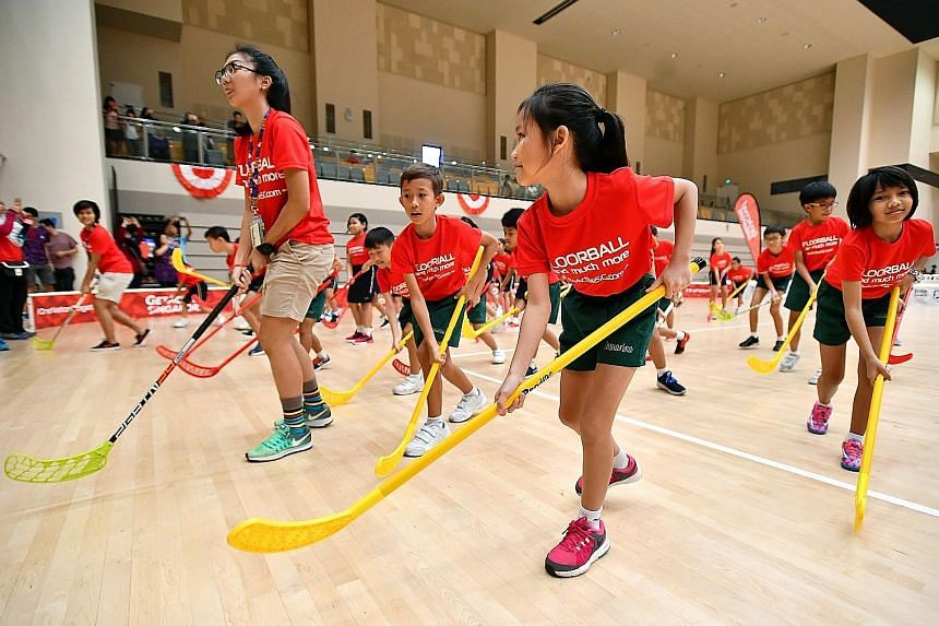 […]Students participate in a workout routine with floorball sticks at the launch of the ActiveSG Floorball Club at Our Tampines Hub. With floorball becoming more popular in Singapore over the last few years, the club intends to help the Singapore F
