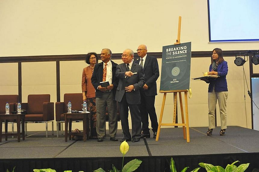 Umno MP Tengku Razaleigh Hamzah (third from left) launching the book in December 2015. With him were (from left) former judge Datuk Noor Farida Ariffin, former secretary-general at the Ministry of Finance Tan Sri Mohd Sheriff Mohd Kassim and a member