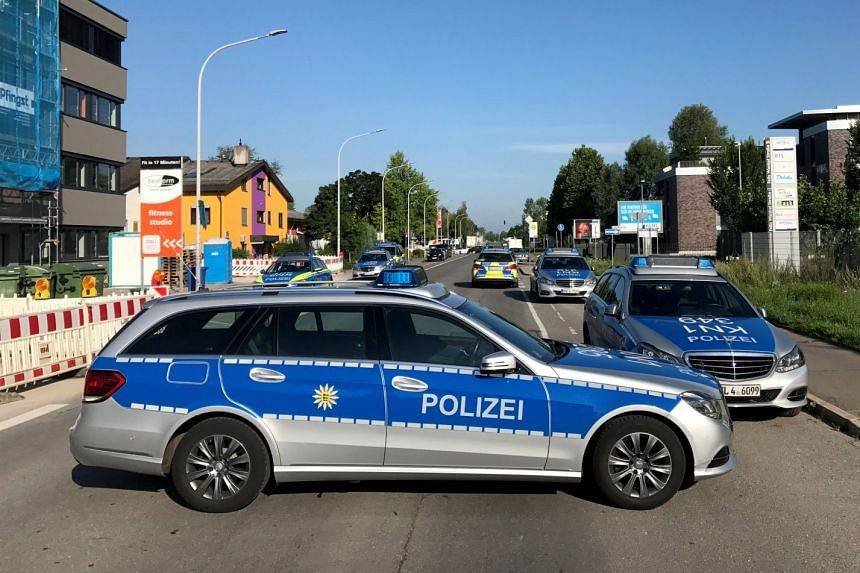 Police cars blocking the street leading to the night club Grey following a shooting incident, in Konstanz, Germany, on July 30, 2017.