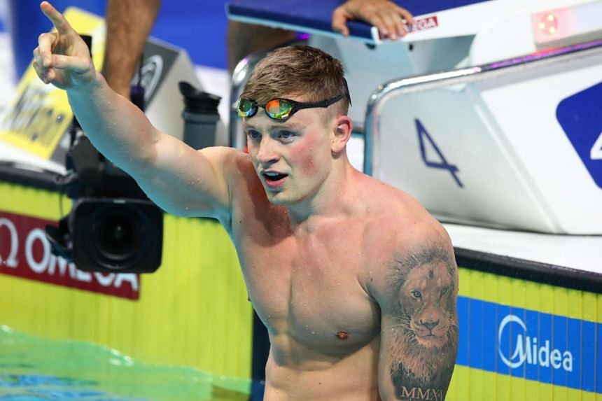 Adam Peaty of Britain reacts after winning the Men's 50m Breaststroke Final at the 17th FINA World Aquatics Championships in Budapest, Hungary on July 26, 2017.