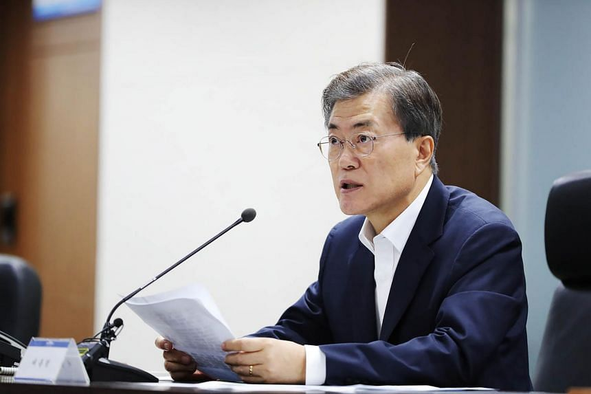 South Korean President Moon Jae In presides over an emergency meeting with National Security Council members at the presidential Blue House in Seoul.