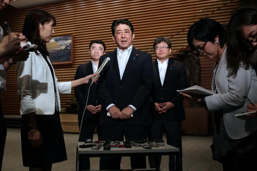Japanese Prime Minister Shinzo Abe speaks to journalists following the launch of North Korea's missile into Japan's EEZ at his official residence in Tokyo on July 29, 2017.