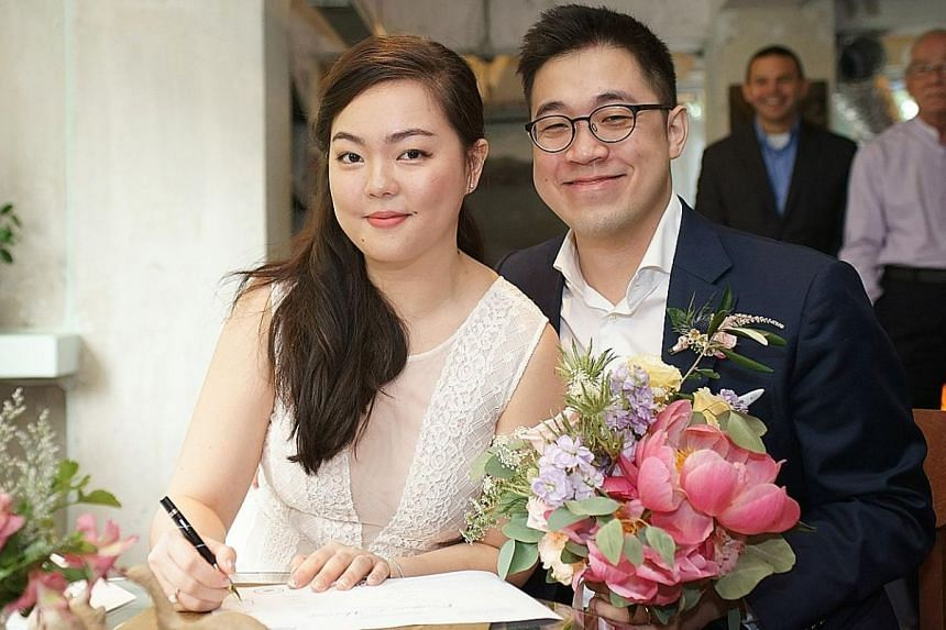 Ms Zoey Low and Mr Joel Ong bought their wedding flowers from Johor Baru, their parents did the floral arrangements and Ms Low's brother spray-painted toy dinosaurs as table decorations.