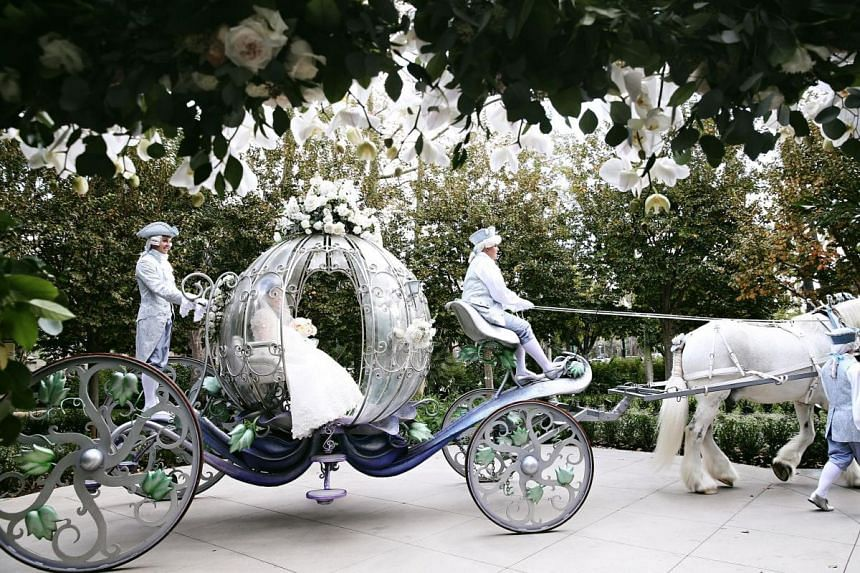 Ms Jessica Goutama, who had her solemnisation at the Disneyland Hotel in Los Angeles, was brought to the ceremony in Cinderella's carriage.