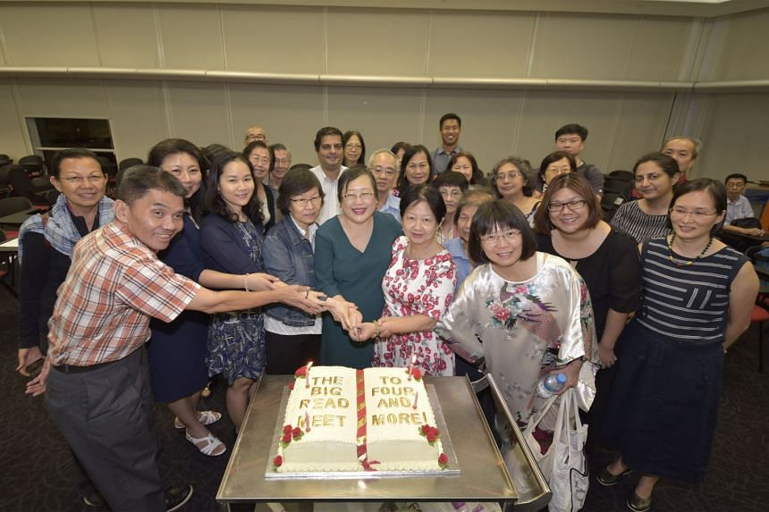 Cutting the Meet's fourth anniversary cake are (front, from left) Meet pioneer Lum Pak Meng, speakers Moe Thuzar and Hoang Thi Ha, Meet pioneer Ong Min Yee, moderator Cheong Suk-Wai and Meet pioneers Tina Wah and Lim Mei Chuen.