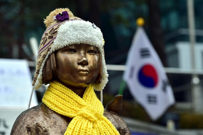 """A statue of a teenage girl symbolising former """"comfort women"""" who served as sex slaves for Japanese soldiers during World War II, in front of the Japanese embassy in Seoul, on Jan 6, 2016."""