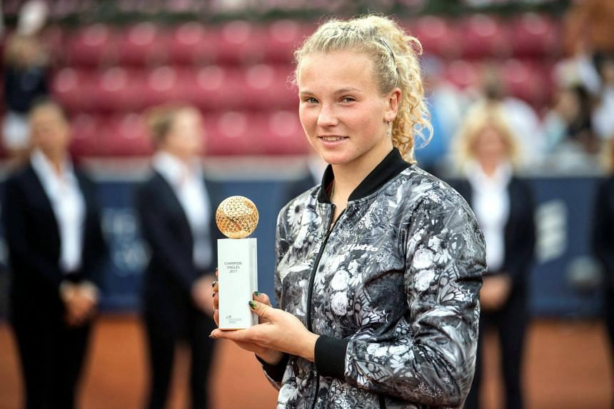 Katerina Siniakova poses with the trophy after winning over Caroline Wozniacki in their women's singles final match at the Swedish Open on July 30, 2017.