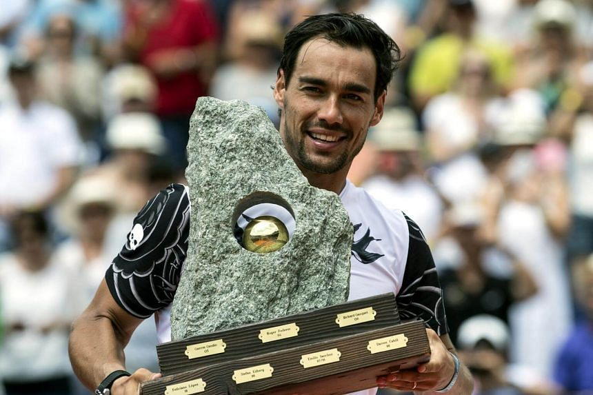 Fabio Fognini of Italy celebrates with the trophy after beating Yannick Hanfmann of Germany in he final of the Swiss Open tennis tournament in Gstaad, Switzerland, on July 30, 2017.