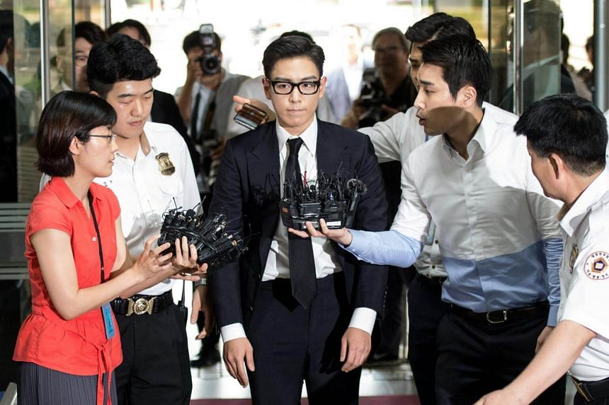 T.O.P, a member of South Korea's boy band Big Bang, arrives at a court in Seoul, South Korea, on July 20, 2017.