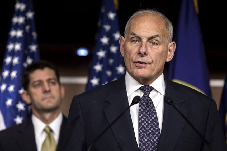 US Homeland Security Secretary John Kelly (right) speaks to the media about immigration enforcement legislation in the US Capitol in Washington, DC on June 29, 2017.