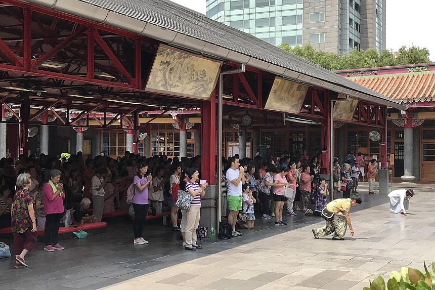 Instead of lighting joss sticks and burning incense paper, devotees at the Xingtian Temple in Taipei's Zhongshan district clasp their hands when praying to the temple's principal deity Guan Yu, the Taoist God of War. Temple helpers light environmenta