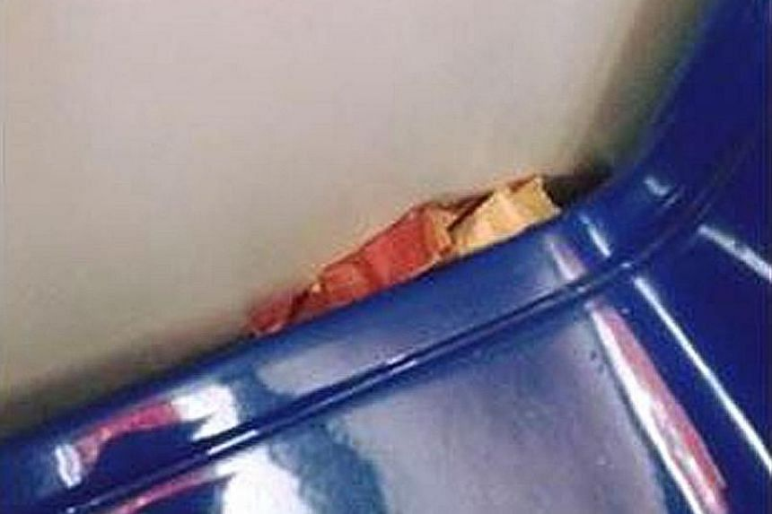 Pictures posted by RapidKL on Facebook show bread stuffed down the side of a seat (above) and a man doing chin-ups in a train. RapidKL uses witty posts to remind people of dos and don'ts on trains.