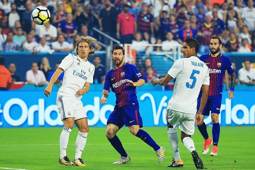 Barcelona talisman Lionel Messi doing what he does best, scoring against arch-rivals Real Madrid in the third minute of their ICC friendly. The teams will play each other again in two weeks at the Camp Nou in the Spanish Super Cup.
