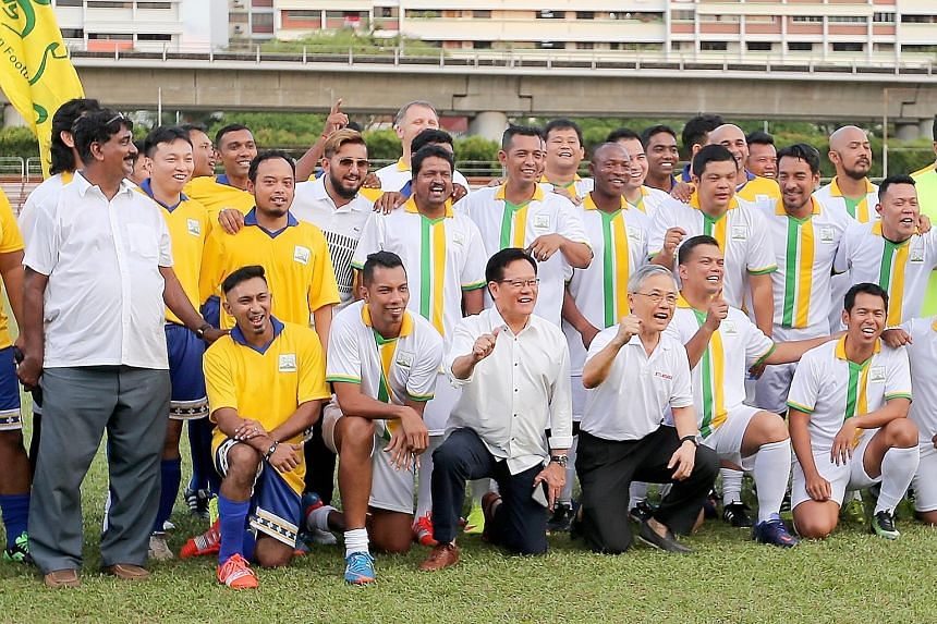 Remembering the Rams' glory days are former Woodlands manager R. Vengadasalam (far left), FAS president Lim Kia Tong (front row, fourth from left), former FAS chief Ho Peng Kee (next to Lim) and former players.