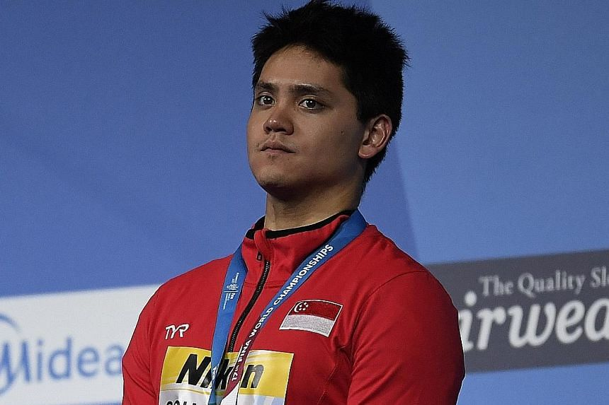 QJoseph Schooling on the podium at the Fina World Championships, after winning a bronze in the 100m butterfly final. The Singaporean gold medallist will knuckle down with the KL SEA Games coming up next month, followed by the Commonwealth Games and A
