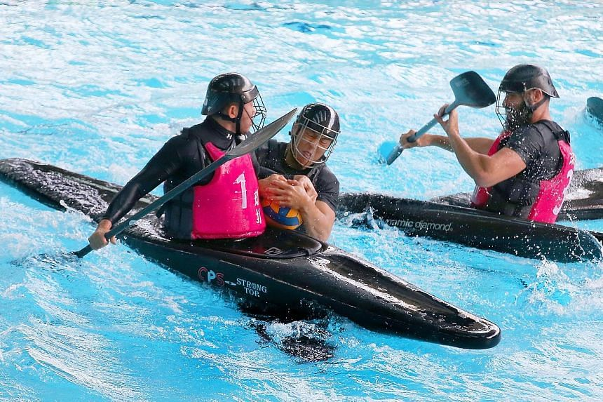 Mogui's Shawn Ng (centre) battling for the ball with XDNH's Poh Tai Cong (left) during the National Canoe Polo Championships men's open final yesterday. Ng's goal was the winner as Mogui ran out first-time winners.