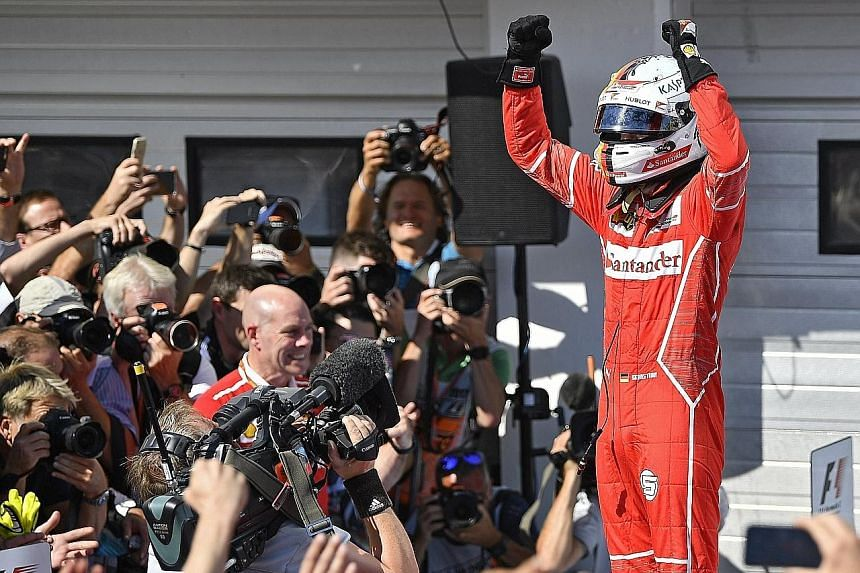 Sebastian Vettel after winning the Hungarian Grand Prix yesterday. His victory, with Lewis Hamilton finishing in fourth place, extended the German's lead in the World Championship to 14 points as the Formula One teams head into the traditional four-w