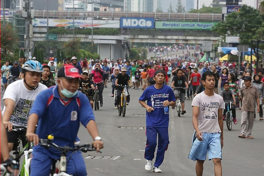 More than 100,000 joggers, cyclists and pedestrians took over the 5km stretch of Jakarta's main thoroughfare in Jalan Sudirman and Jalan Thamrin yesterday.