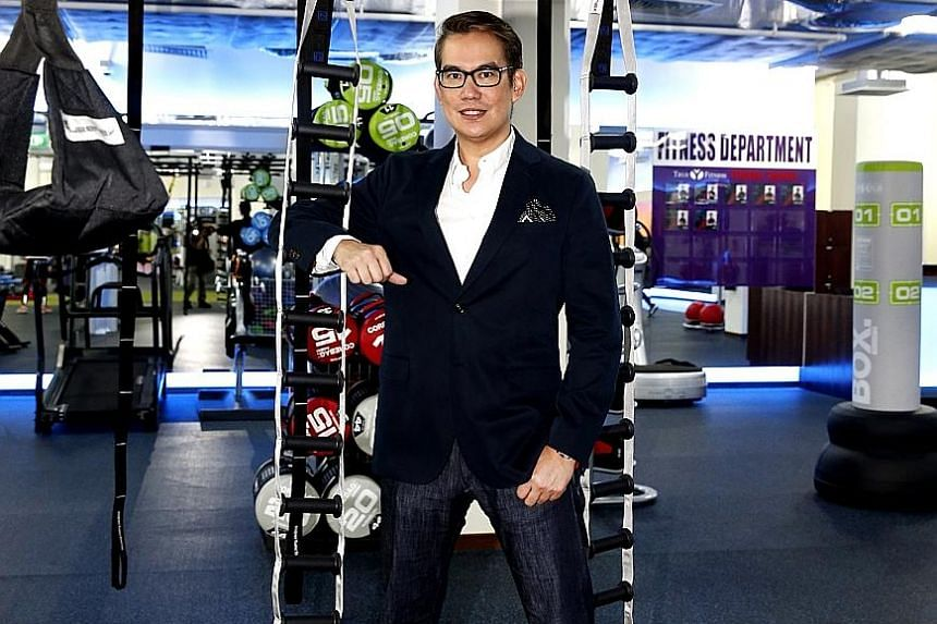 """Mr Patrick Wee, whose company has grown to 26 clubs with more than 110,000 members, plans to launch a new chain of boutique fitness clubs in Singapore. """"We want to reassure members that it's business as usual. As a matter of fact, we are going bigger"""