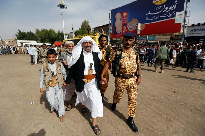 Father of the victim Yahya al-Matari (centre) walking to the execution site of Mohammed al-Moghrabi, in Sanaa, Yemen, on July 31, 2017.