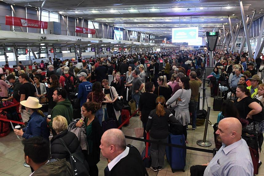 Long lines form at Sydney Airports T2 Domestic Terminal as passengers are subjected to increased security, Sydney, Australia, on July 31, 2017.