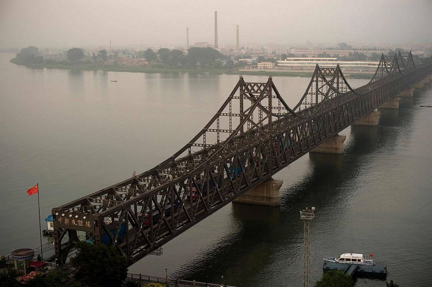 Trucks are seen crossing the Friendship Bridge from the Chinese border city of Dandong to North Korea's Sinuiju, on July 5, 2017.