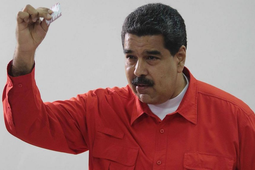 President Nicolas Maduro casting his vote in Caracas, on July 30, 2017.