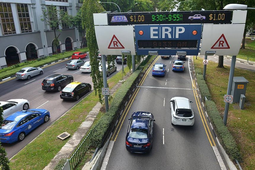 Cars travelling though an electronic road pricing (ERP) gantry near the State Courts, on July 13, 2016.