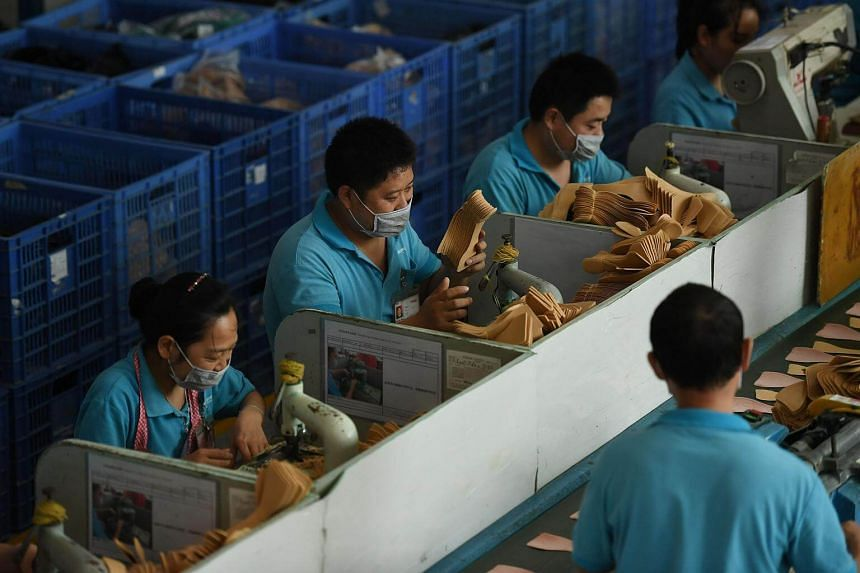 Workers on a production line at the Huajian shoe factory in Dongguan, China on Sept 14, 2016.