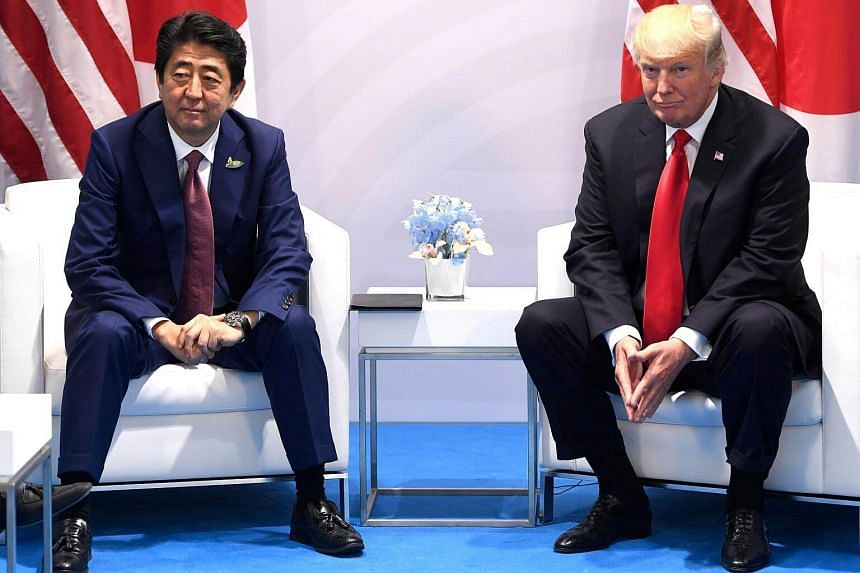 US President Donald Trump and Japanese Prime Minister Shinzo Abe hold a meeting on the sidelines of the G20 Summit in Hamburg, on July 8, 2017.