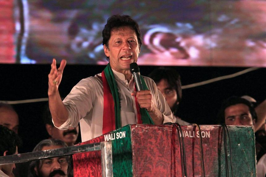 Opposition leader Imran Khan speaks to supporters in Islamabad, on July 30, 2017.