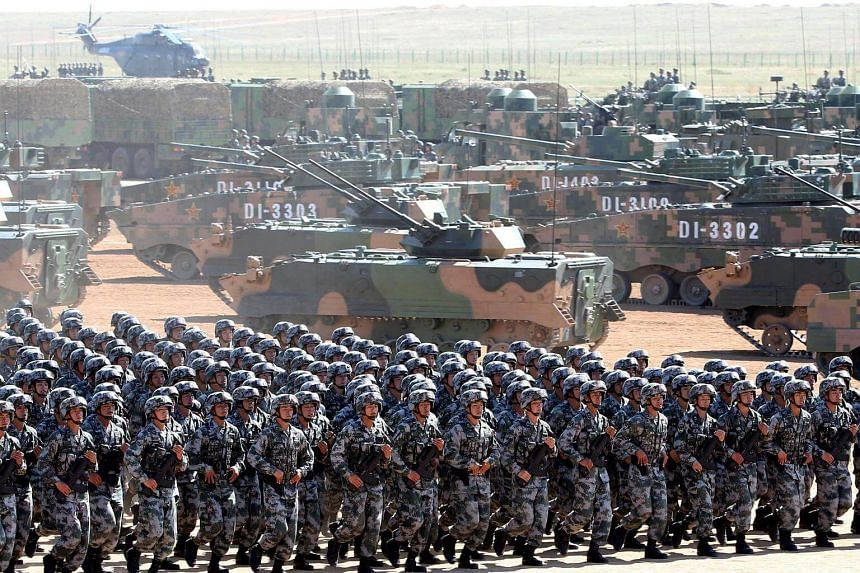 Soldiers of China's People's Liberation Army (PLA) take part in a military parade at the Zhurihe military training base in Inner Mongolia on July 30, 2017.