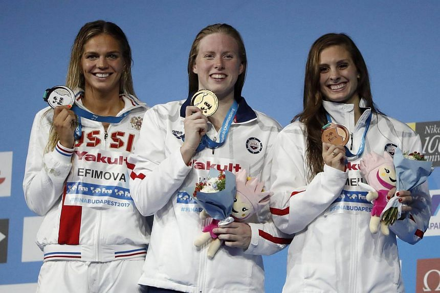 (From left) Yuliya Efimova, Lilly King and Katie Meili pose with their medals.