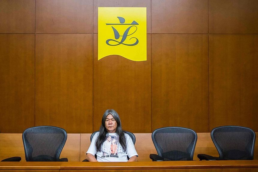 Pro-democracy lawmaker Leung Kwok-hung sits alone at a press conference in Hong Kong on July 14, 2017.