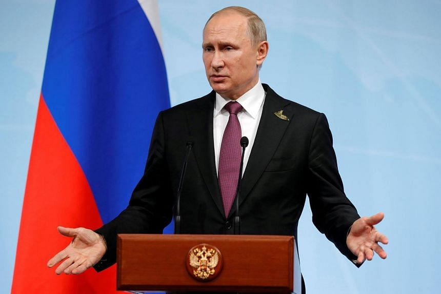 Russian President Vladimir Putin speaking at a news conference after the G20 summit in Hamburg, northern Germany, on July 8, 2017.