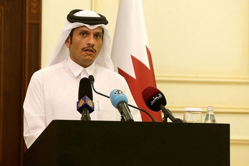 Qatari Foreign Minister Sheikh Mohammed bin Abdulrahman Al-Thani answers questions during a press conference in Doha, on July 11, 2017.