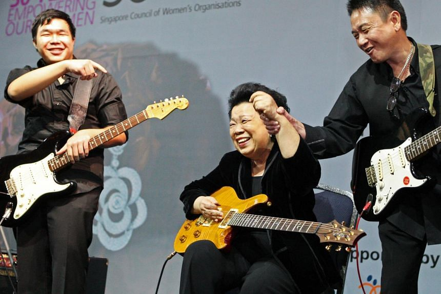 Grandma Ho, who is the mother-in-law of former Foreign Affairs George Yeo, performs with grandson Bertrand (left) and music teacher Spencer Goh at the Singapore Council of Women's Organisations 30th anniversary gala dinner held at Shangri-La Hotel on