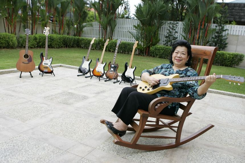 Grandma Ho, seen here in 2007, has a collection of more than 10 guitars - including a Gibson Les Paul.