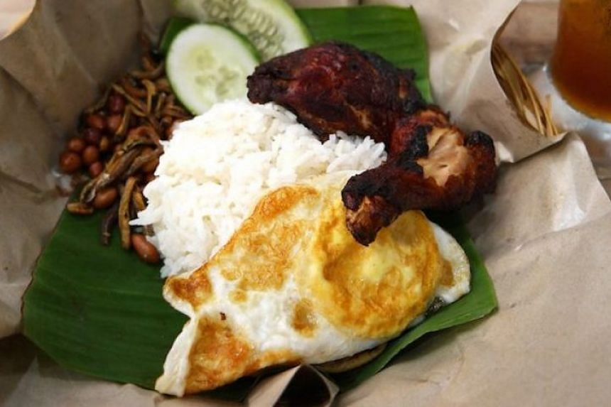 Nasi lemak - the ubiquitous banana leaf-wrapped packet of coconut rice topped with fiery sambal, fried peanuts, hard-boiled eggs, anchovies and cucumbers - is a breakfast staple throughout Malaysia.