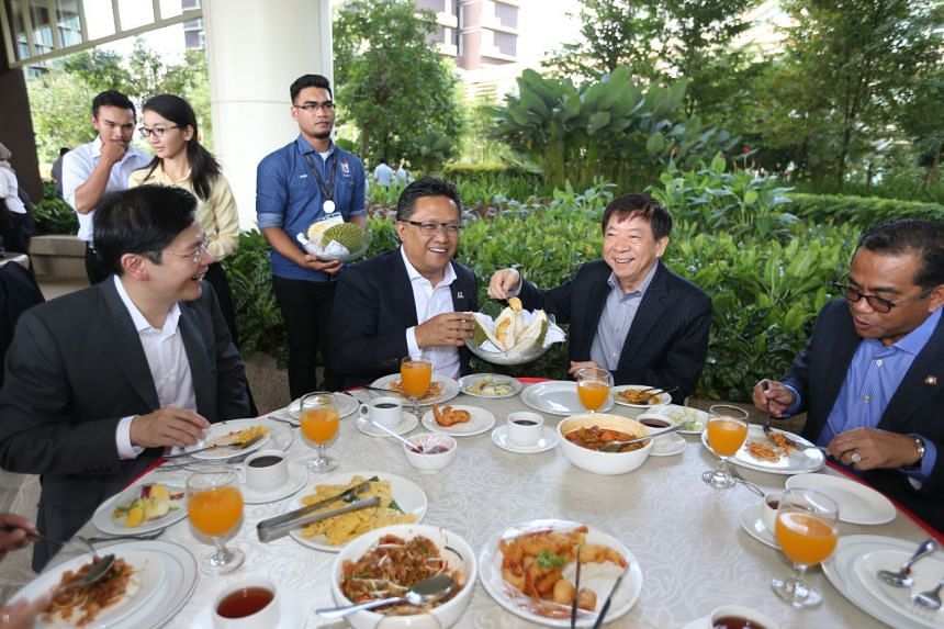 Minister for Infrastructure and Transport Minister Khaw Boon Wan and Malaysia's Minister in the Prime Minister's Department Abdul Rahman Dahlan during a hi-tea session at the CIMB Leadership Academy on July 31 2017.