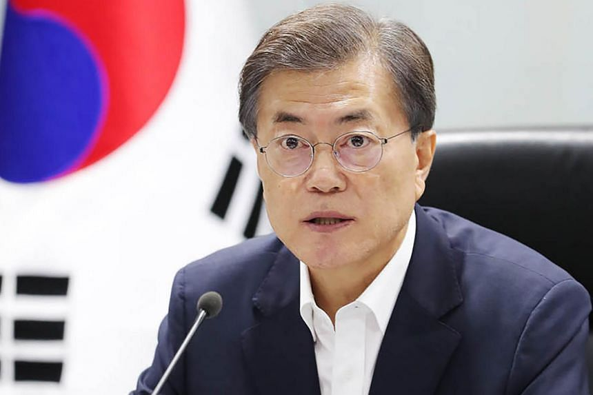 In this handout from the Blue House taken on July 29, 2017, South Korean President Moon Jae In presides over an emergency meeting with National Security Council members at the presidential Blue House.