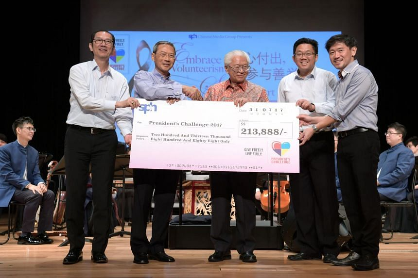 President Tony Tan receiving a cheque from SPH Chairman, Lee Boon Yang (second from left).
