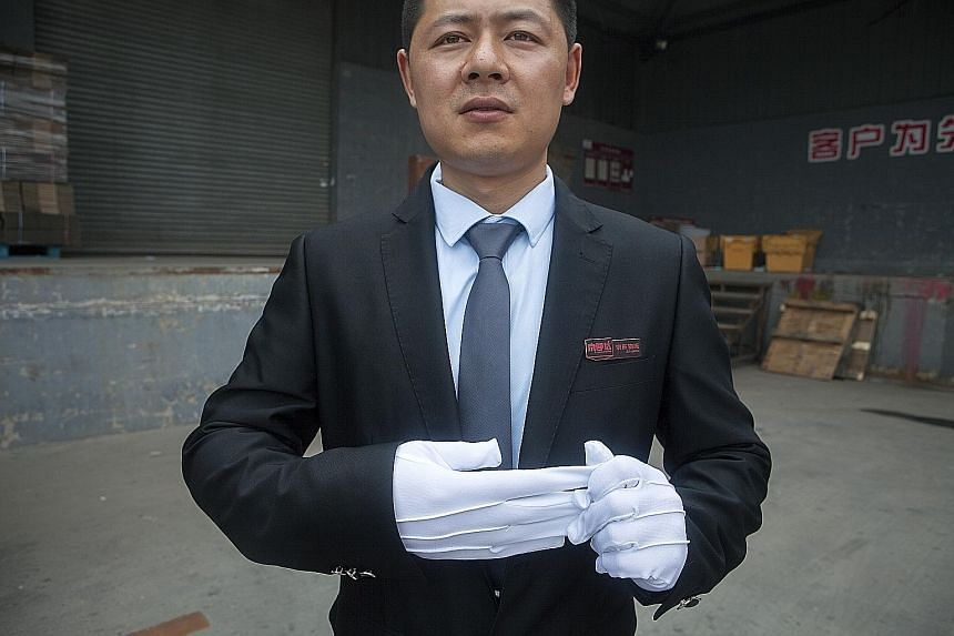 Mr Tang Hongliang, a driver for JD.com luxury service, does not look like a typical Chinese package courier. Instead of hot noodle lunches, he delivers luxury goods such as designer handbags.