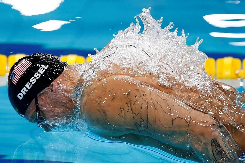 Caeleb Dressel of the United States on his way to winning the 100m fly in Budapest last Saturday. He came within four-hundredths of a second of Michael Phelps' world record on a day when he won three gold medals.
