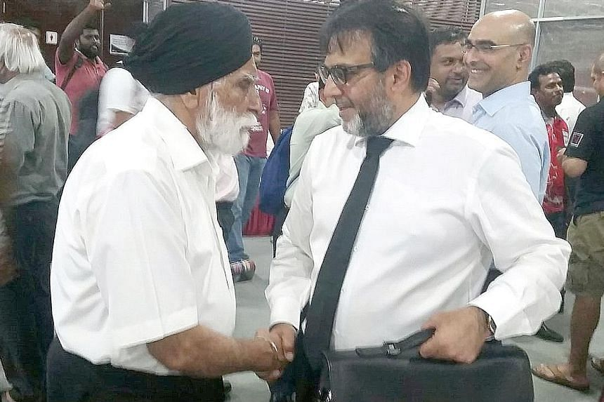 Mahmood Gaznavi being congratulated by Harbans Singh, a Singapore Cricket Association life member and a former president.