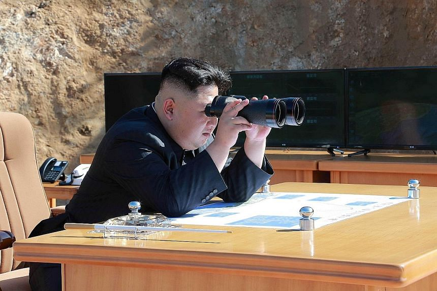 North Korean leader Kim Jong Un observing the test-firing of the Hwasong-14 intercontinental ballistic missile in this undated photo released by the Korean Central News Agency on July 4. The map on his table has come under intense scrutiny, and purpo