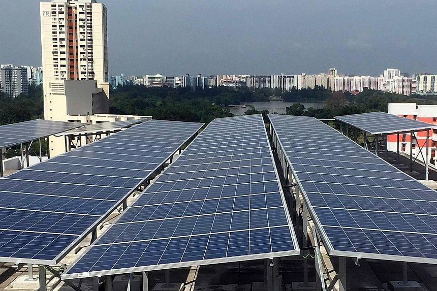 Solar panels on the rooftop of an HDB block in Jurong East. Research is being done to see how Singapore can overcome its space constraints to have more solar panels installed.